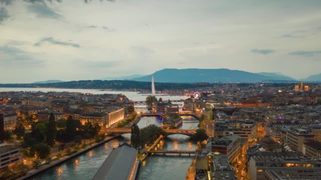 sunset sky illumination geneva city center river to lake aerial panorama 4k timelapse switzerland - vídeo