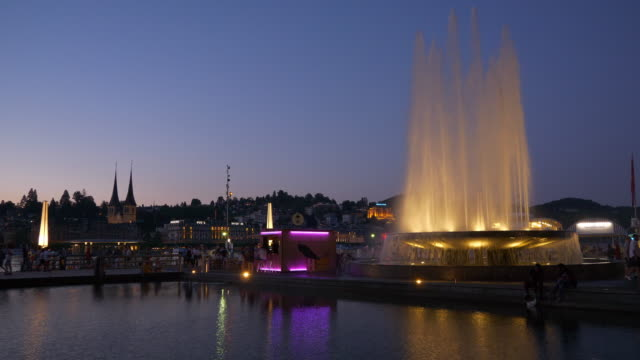 sunset sky luzern city lakeside bay modern art museum square fountain panorama 4k switzerland - vídeo