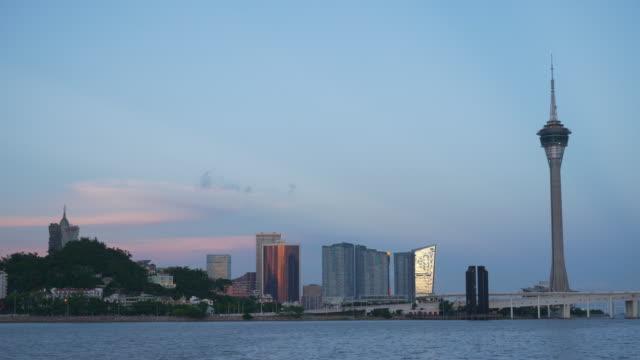 sunset sky magic zhuhai city famous macau tower bay panorama 4k china - zhuhai video stock e b–roll