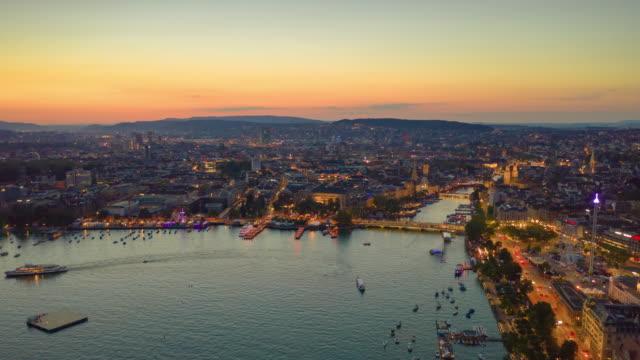 sunset sky night illuminated flight over zurich lakeside aerial panorama 4k timelapse switzerland - vídeo