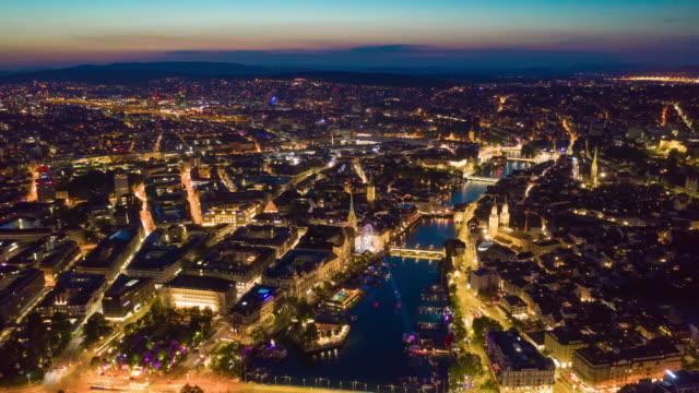 sunset sky night illuminated flight over zurich riverside aerial panorama 4k timelapse switzerland video