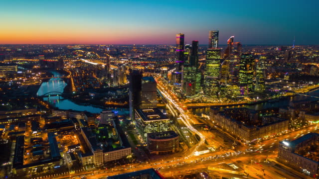 sunset sky night illuminated moscow city traffic street aerial cityscape panorama 4k time lapse russia