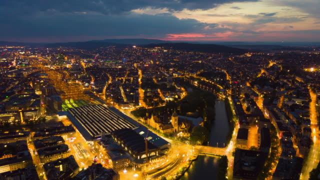 sunset sky night illuminated zurich cityscape traffic street aerial panorama 4k time lapse switzerland - szwajcaria filmów i materiałów b-roll