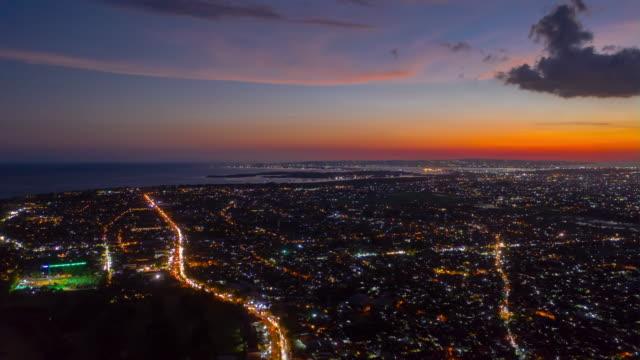 sunset sky night illumination bali island traffic roads aerial timelapse panorama 4k indonesia