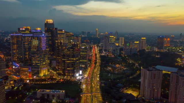 sunset sky night illumination jakarta city downtown busy traffic street aerial panorama 4k indonesia - vídeo