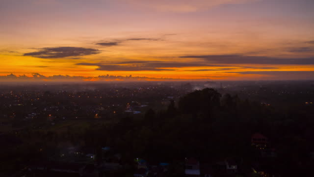 sunset sky night life illumination bali island village traffic aerial timelapse panorama 4k indonesia