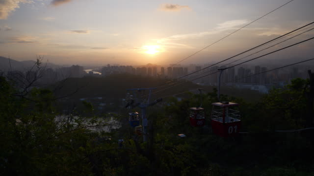 sunset sky zhuhai cityscape park view funicular line panorama 4k china - zhuhai video stock e b–roll