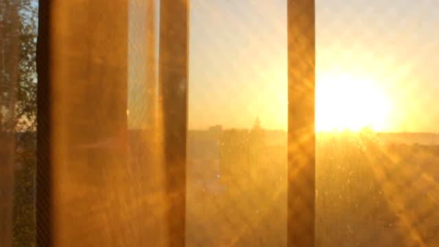 sunset sunrise view through transparent curtain - penombra video stock e b–roll