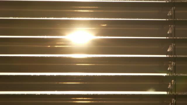 Sunset through some shutter video