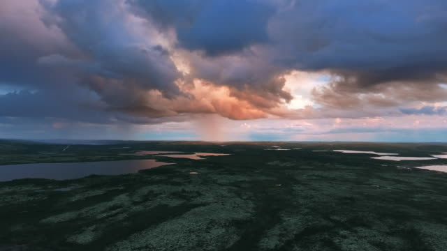 Sunset through the rain clouds in the tundra video