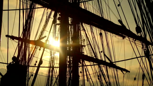 sunset through the rigging of a sailing ship