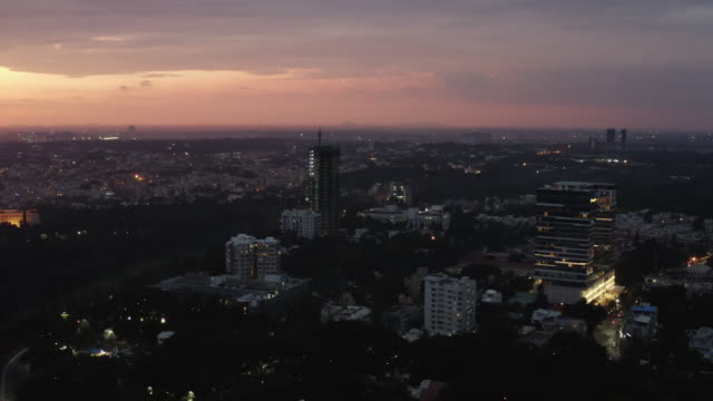 sunset time bangalore cityscape skyscraper construction high aerial panorama 4k india - vídeo