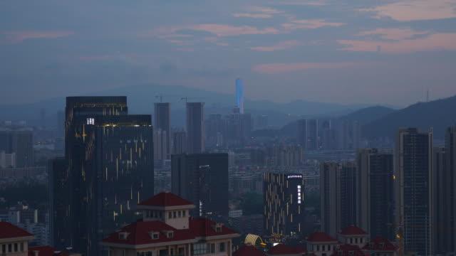 sunset time illuminated zhuhai cityscape park top panorama 4k china - zhuhai video stock e b–roll