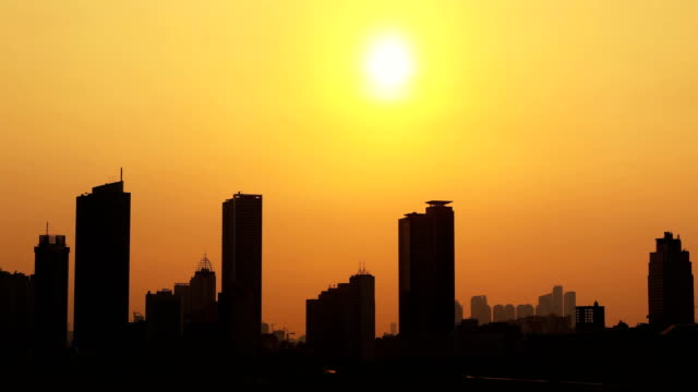 Sunset time lapse with silhouette of high rise buildings Beautiful golden sunset time lapse with silhouette of high rise buildings in Jakarta, Indonesia jakarta stock videos & royalty-free footage