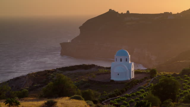 sunset time santorini island bay church hill top panorama 4k time lapse greece - fire filmów i materiałów b-roll