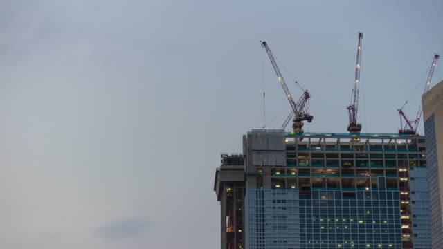 sunset time singapore city center construction top cranes panorama timelapse 4k sunset time singapore city center construction top cranes panorama timelapse 4k construction machinery stock videos & royalty-free footage