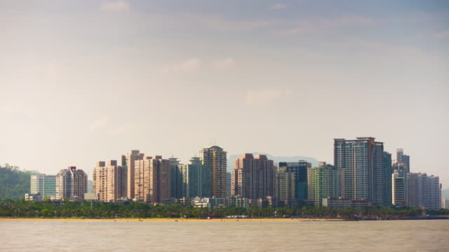 sunset time zhuhai city beach coastline bay panorama 4k time lapse china - zhuhai video stock e b–roll