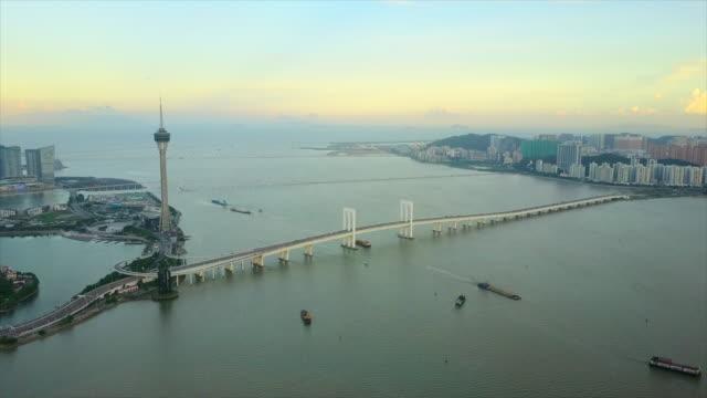 sunset time zhuhai city macau famous tower bridge panorama 4k china - zhuhai video stock e b–roll