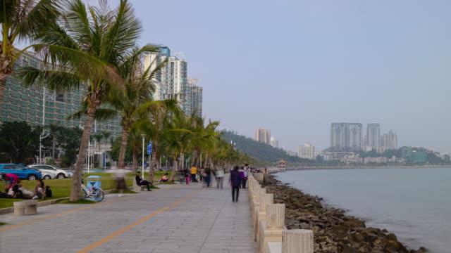 sunset time zhuhai city tourist crowded promenade bay panorama timelapse 4k china - zhuhai video stock e b–roll