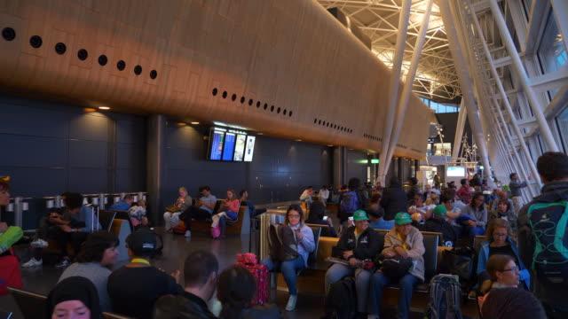 stockvideo's en b-roll-footage met zonsondergang tijd zürich stad luchthaven poorten zone panorama 4k zwitserland - vliegveld vertrekhal