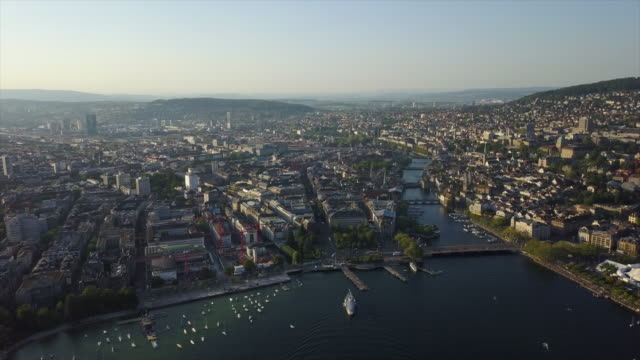 sunset time zurich city center river and lake aerial panorama 4k switzerland