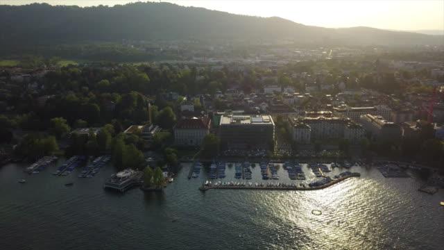 sunset time zurich city lake bay park dock aerial panorama 4k switzerland