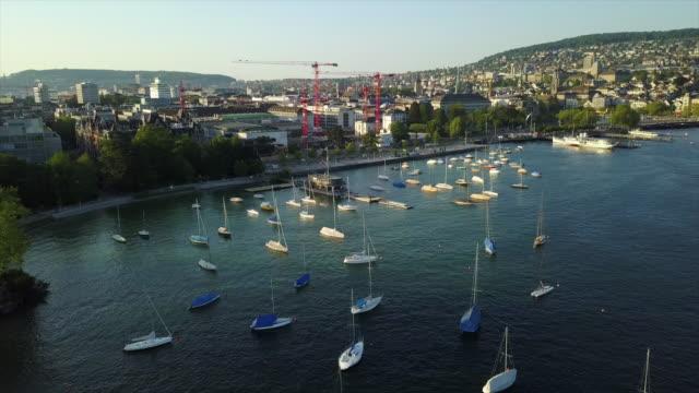 sunset time zurich city lake bay yacht dock traffic aerial panorama 4k switzerland