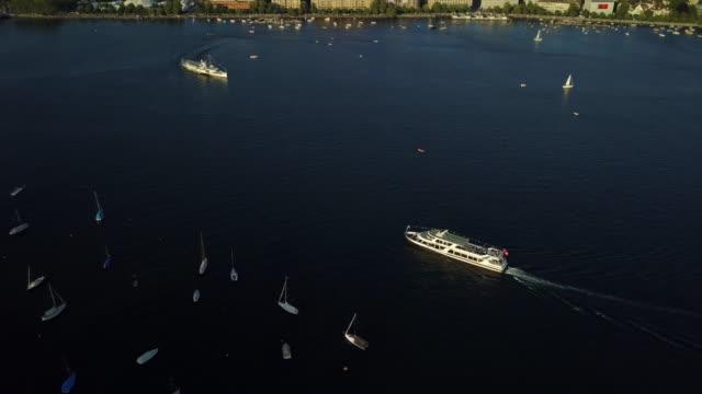 sunset time zurich city lake ferry ride aerial panorama 4k switzerland