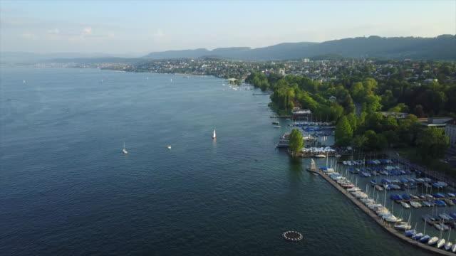sunset time zurich city lakeside dock aerial panorama 4k switzerland