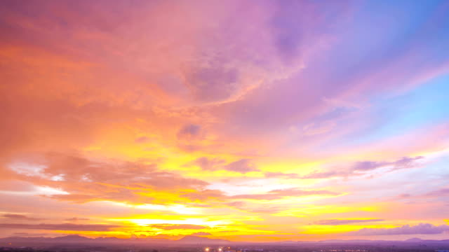 sunset timelapse against cityscape at trang thailand - dusk stock videos & royalty-free footage
