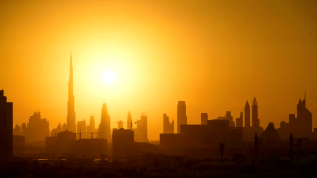 dubai sunset timelapse skyline - dubai architecture stock videos & royalty-free footage