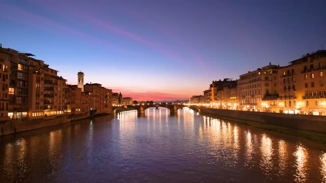 Sunset, twilight of Arno river and bridge Trinita in Florence italy daytime