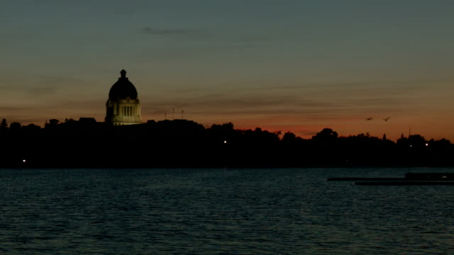 Sunset view of lake and government building video