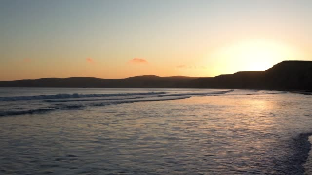 Sunset view of the Pacific Ocean shoreline; Drakes Beach, Point Reyes National Shoreline, California