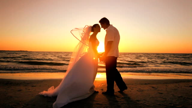 sunset wedding kiss - wedding fashion stock videos and b-roll footage
