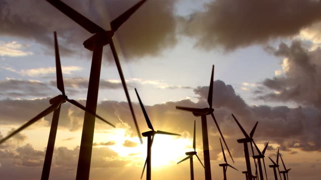 Sunset Wind Turbines 2 Wind Turbines over a sunset background. loop. wind power stock videos & royalty-free footage