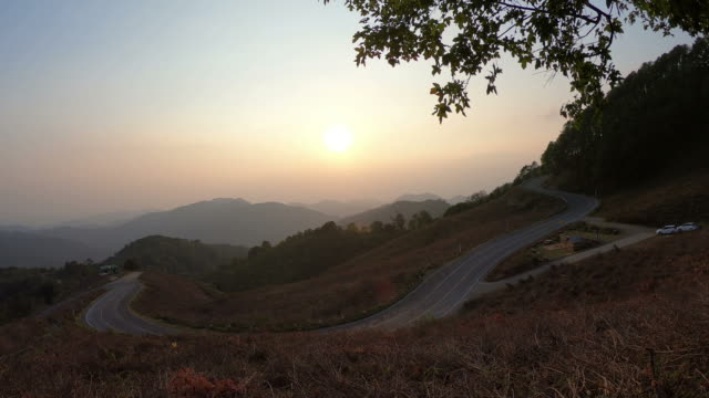 sunset with layer mountain and road in Thailand