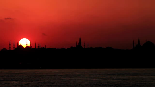 Sunset with sun behind silhouette in Istanbul,Turkey video