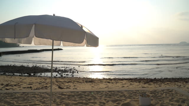 Sunset with umbrella deck chair pool video