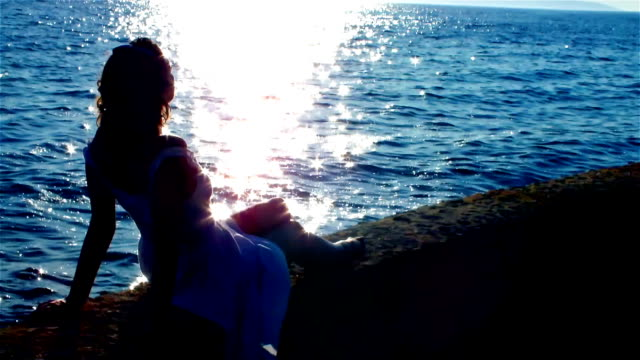Sunset, woman and sea video