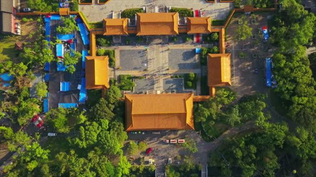 sunset zhuhai famous new nuanming park entrance temple aerial panorama 4k china - zhuhai video stock e b–roll
