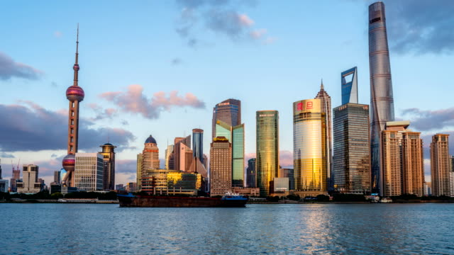 Shanghai, China - November 1, 2016: A sunset-to-dusk time-lapse of panoramic view of busy Huangpu River and modern skyscrapers at east side of the river in Lujiazui Pudong New Area, looking from the Bund at west side of the river in central Shanghai. Sunset Huangpu River - A sunset-to-dusk time-lapse of panoramic view of busy Huangpu River and modern skyscrapers at east side of the river in Lujiazui Pudong New Area, looking from the Bund at west side of the river in central Shanghai, China shanghai stock videos & royalty-free footage