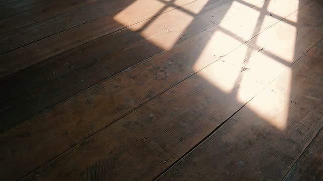 sunshine through windows with shadows on wooden floor old