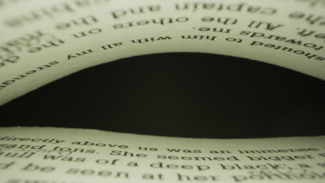 Super close up of a virtual camera view, getting through the pages of an anonymous book.