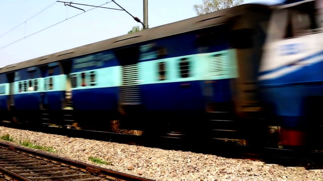 Super fast train running on railroad track Super fast train running on railroad track intercity stock videos & royalty-free footage