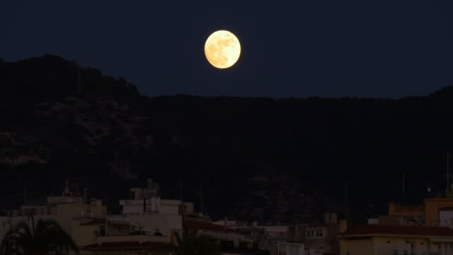 super moon 4k night light close up sitges spain video