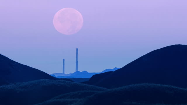 Super moon on the background of mining production. Time lapse of amazing super moon. Industrial concept. Factory pipes. Calm evening sky. kazakhstan stock videos & royalty-free footage