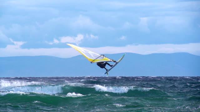 HD Super Slo-Mo: Man Jumping Wave on Windsurf Board video
