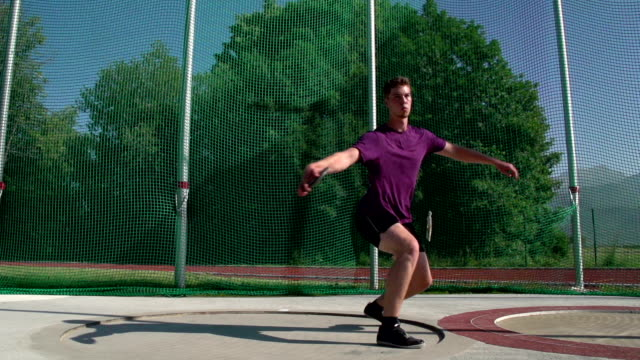 HD: Super Slo-Mo Shot of male discus thrower in action video
