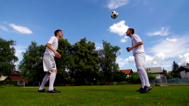 HD: Super Slo-Mo Shot of Men Practicing Soccer video